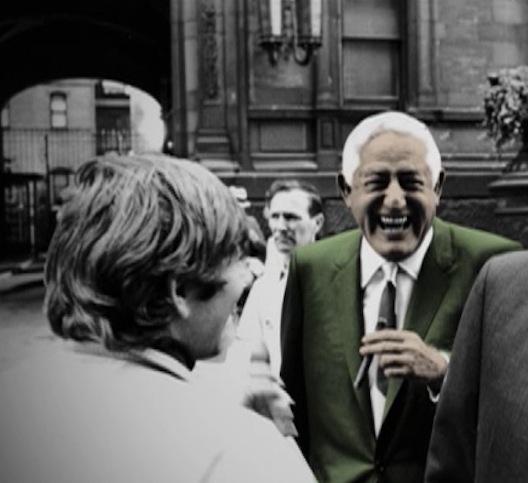 bill in crowd green jacket
