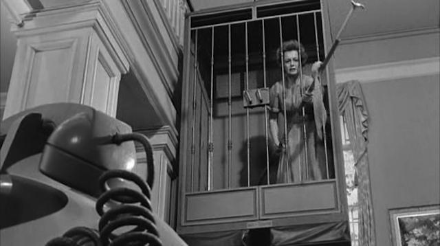 de Havilland in Lady in a Cage