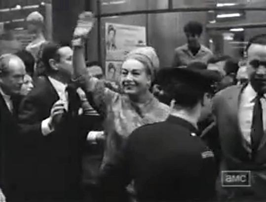 Joan greets crowd on set of Hush