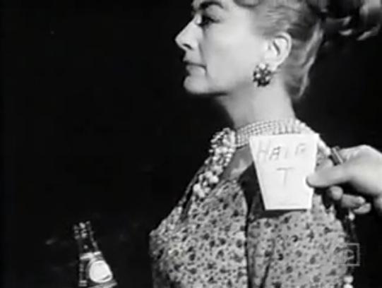 Joan hair shot with coke bottle
