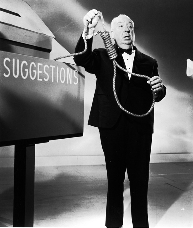 alfred-hitchcock-on-the-set-of-alfred-hitchcock-presents-showing-off-a-noose