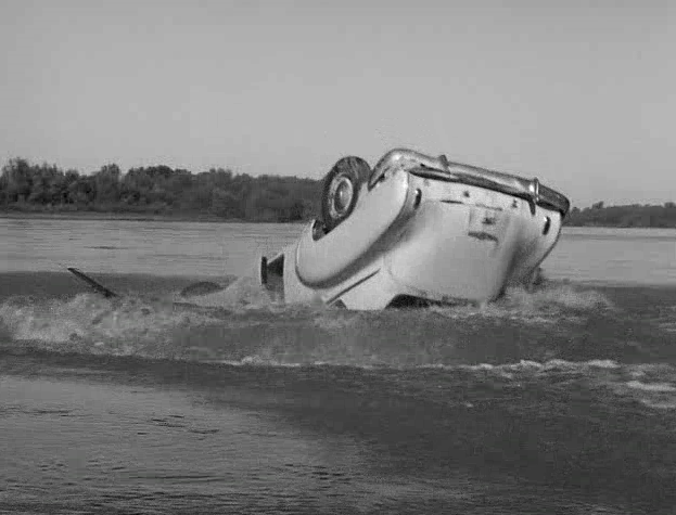 car goes into the river