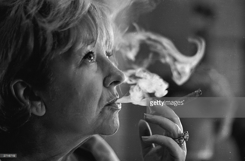 actress-beryl-reid-learning-to-smoke-a-cigar-for-her-role-in-the-play-picture-id2716719