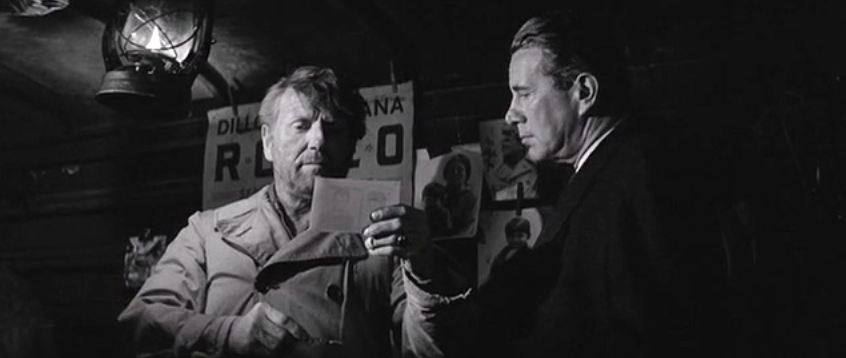 CapturFiles_25 Forsythe shows Perry's dad McGraw a photo to confirm his identity