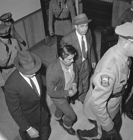Perry Smith led by police into the Garden City Kansas courthouse on Jan. 6 1960 charged with first degree murder