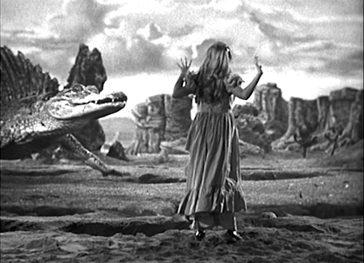 Two Lost Worlds Nancy Holden and a dinosaur this aint Alice through the Looking Glass